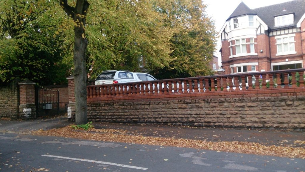 Entrance to the car park and Creating Space dedicated car parking space (where the white van is parked in the photo)